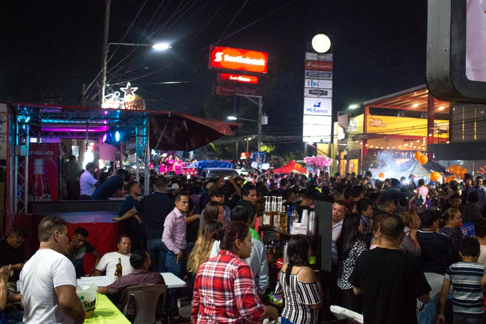 Many people in a crowd outside at night