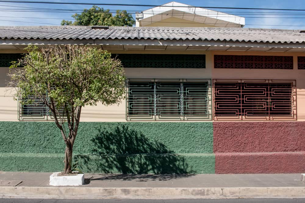 Building with red and green paint on either side