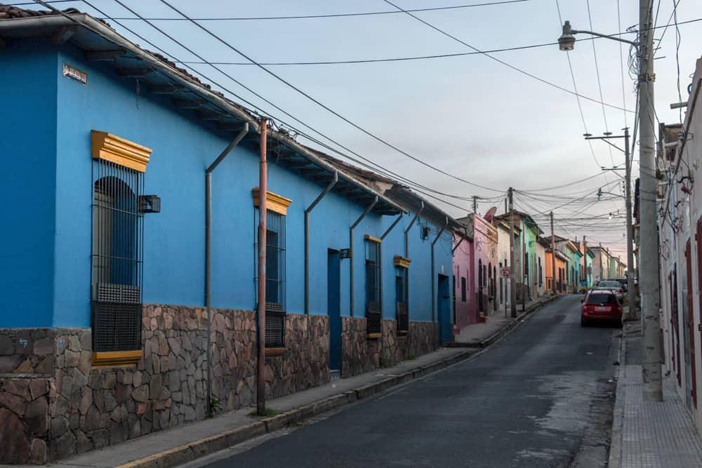 Blue building on a street in Santa Ana El Salvador