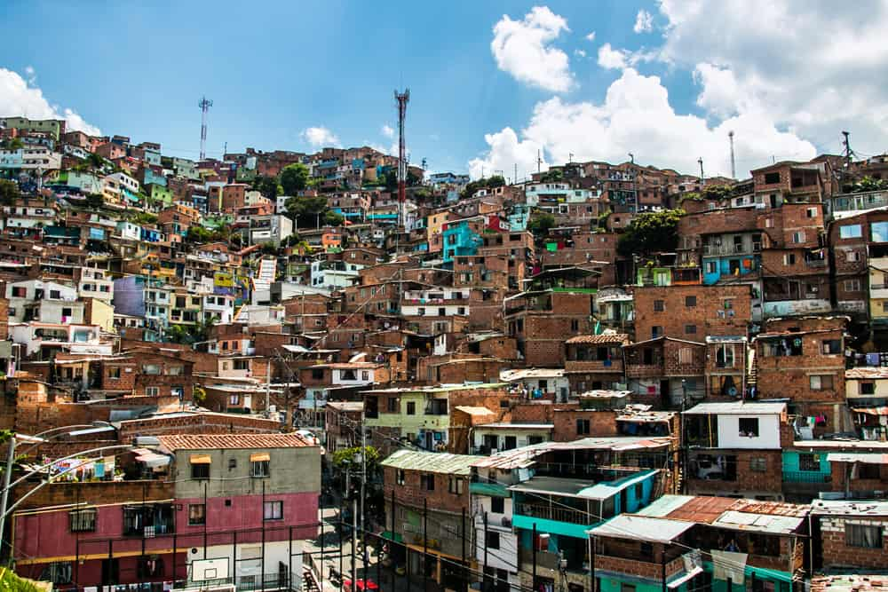 Different coloured buildings on a hillside