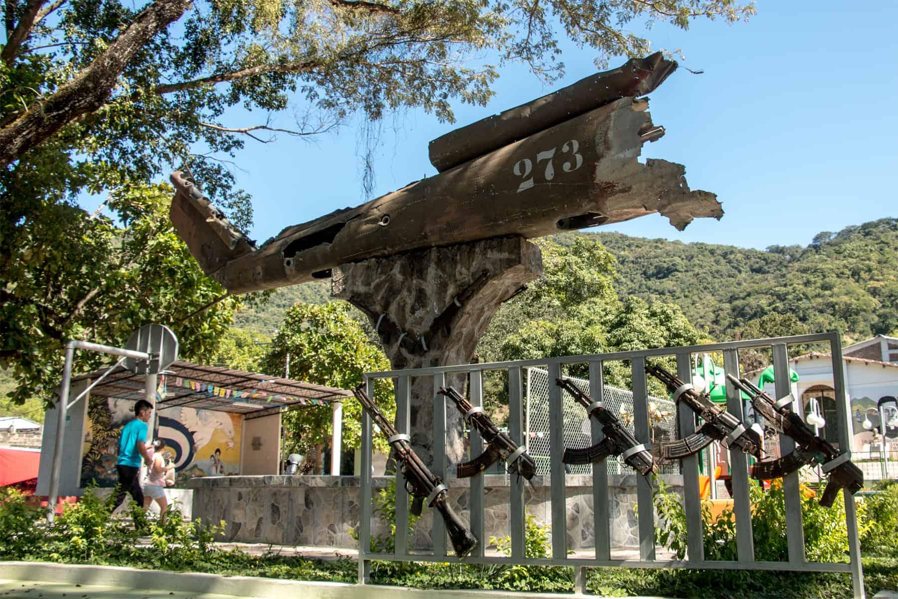 Damaged helecopter and guns from Salvadorian Civil War