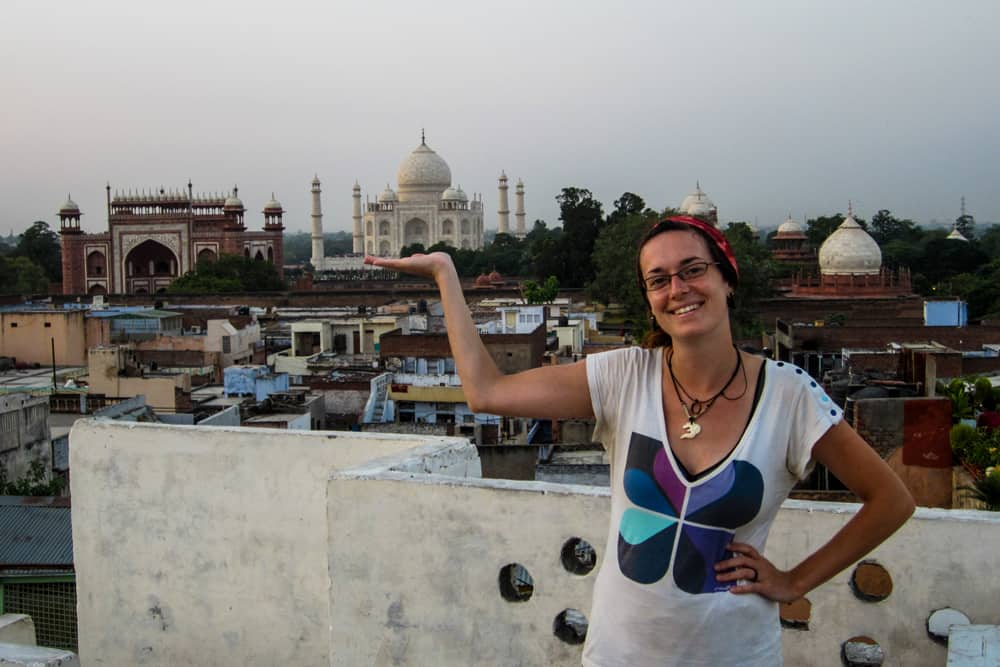 Woman posing with the Taj Mahal in the background
