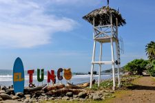 "Wooden lifeguard lookout and coloured letters spelling ""El Tunco"""