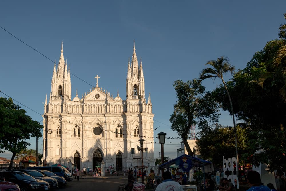 White, gothic cathedral at the end of a busy street in Santa Ana