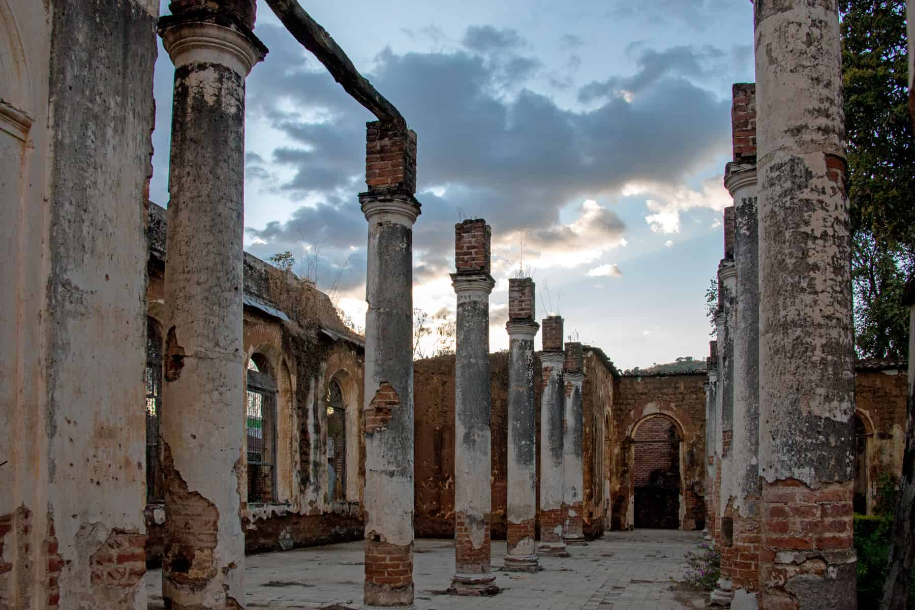 Crumbling pillars of a ruined building at sunset in Santa Ana El Salvador