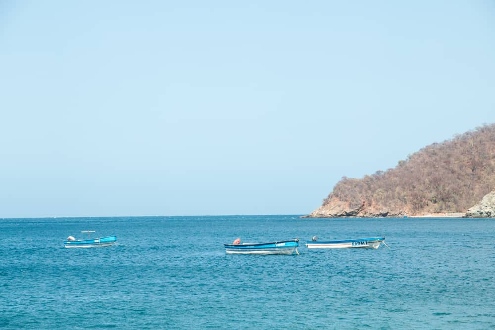 Boats floating in Caribbean sea at Bahia Concha Colombia