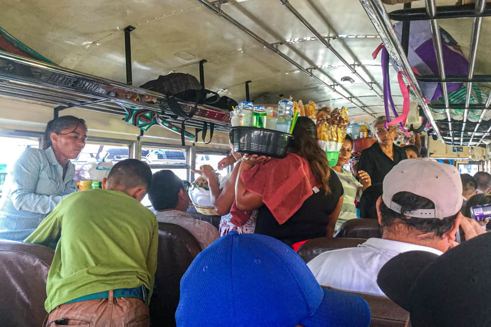 Many people on a crowded bus