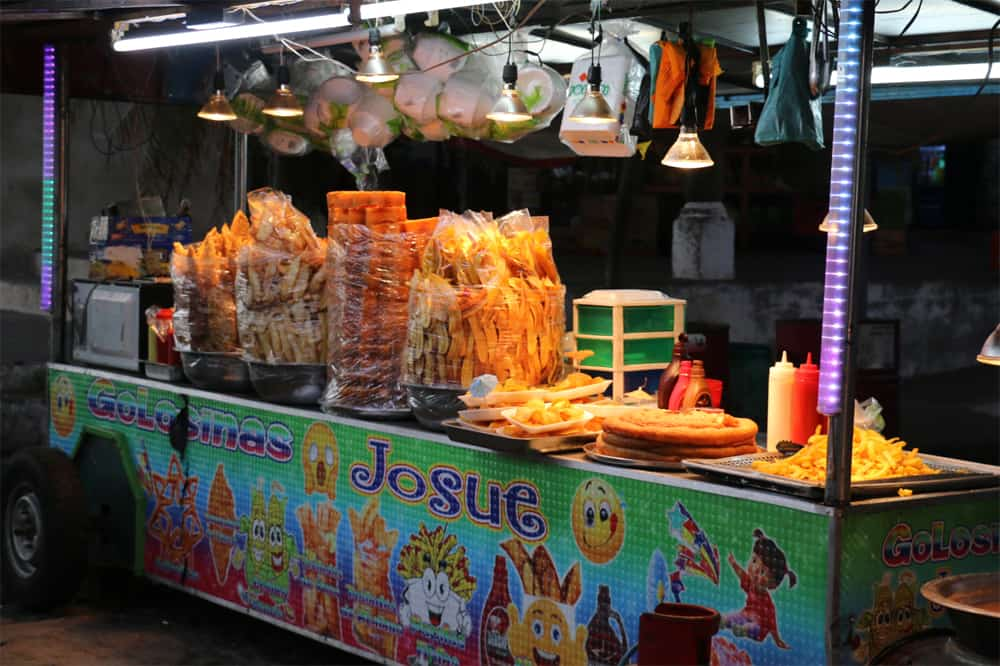 Food cart at night with several options of fried snacks