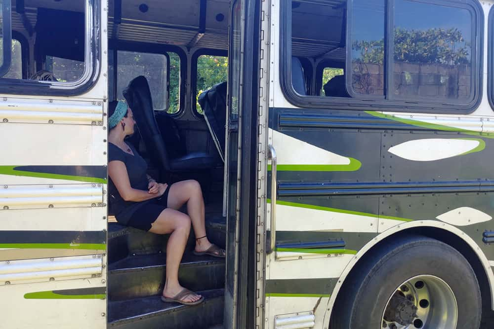 Woman sitting in the doorway of a bus