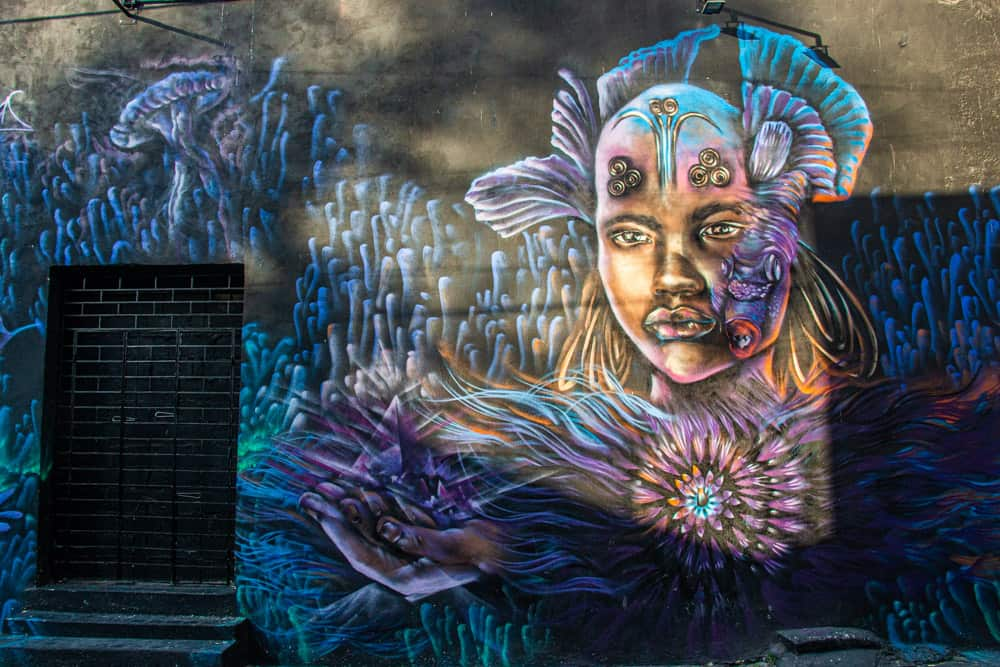 Colourful street art of a woman on a wall