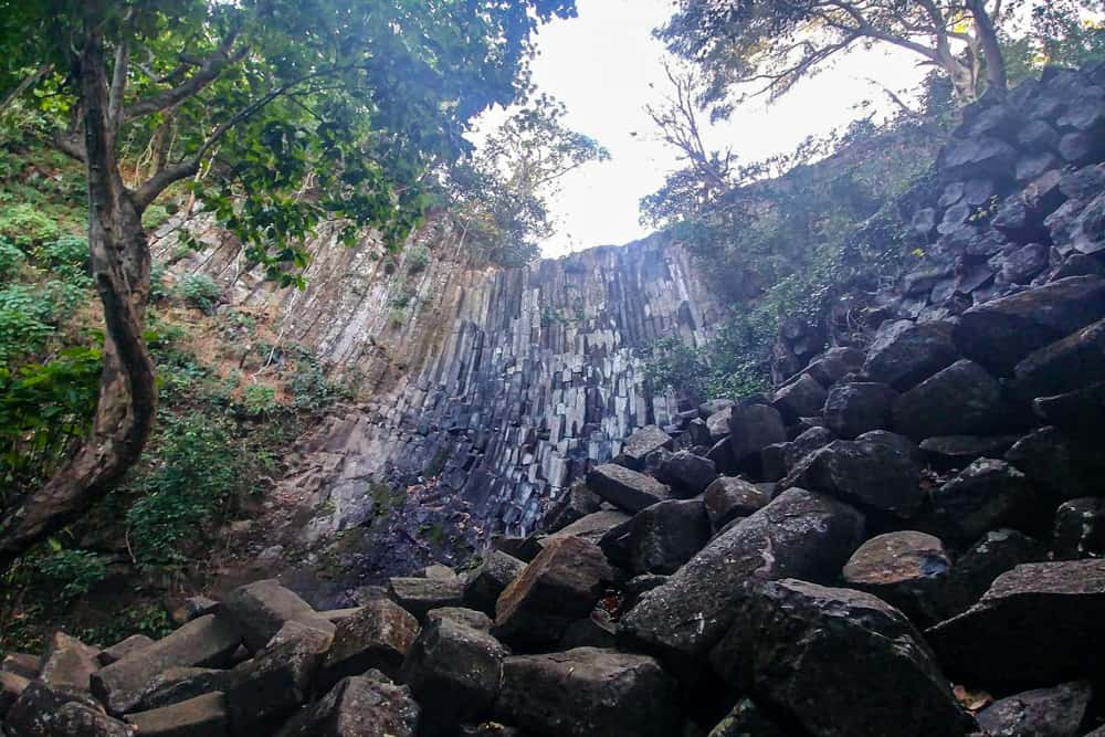 Rocks and a dry waterfall with green trees in Suchitoto El Salvador