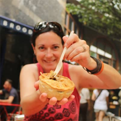 Woman holding a meat pie