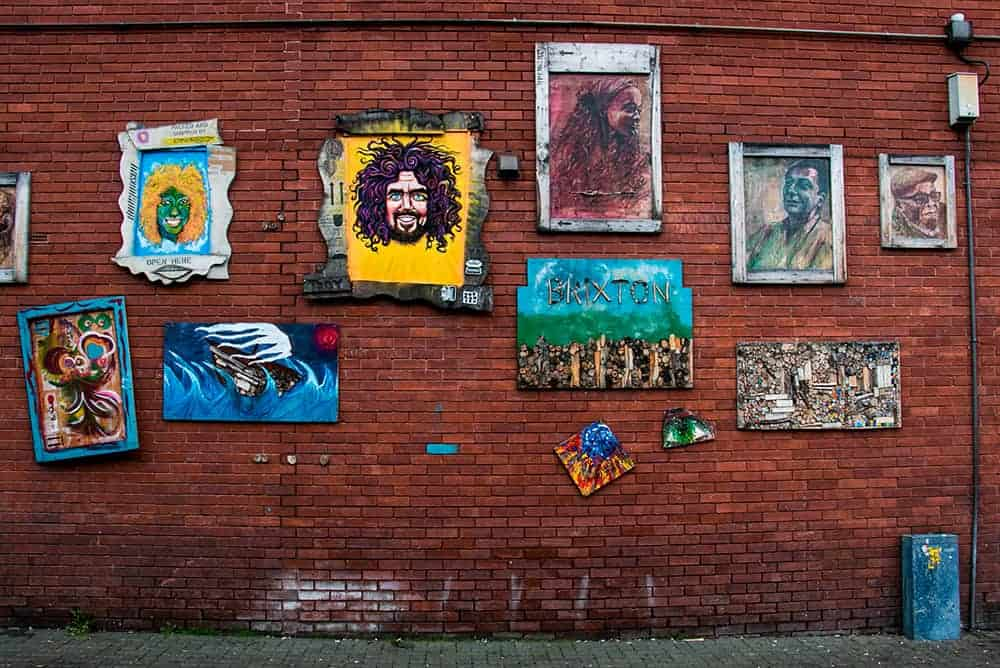 Random pieces of art on a brick wall