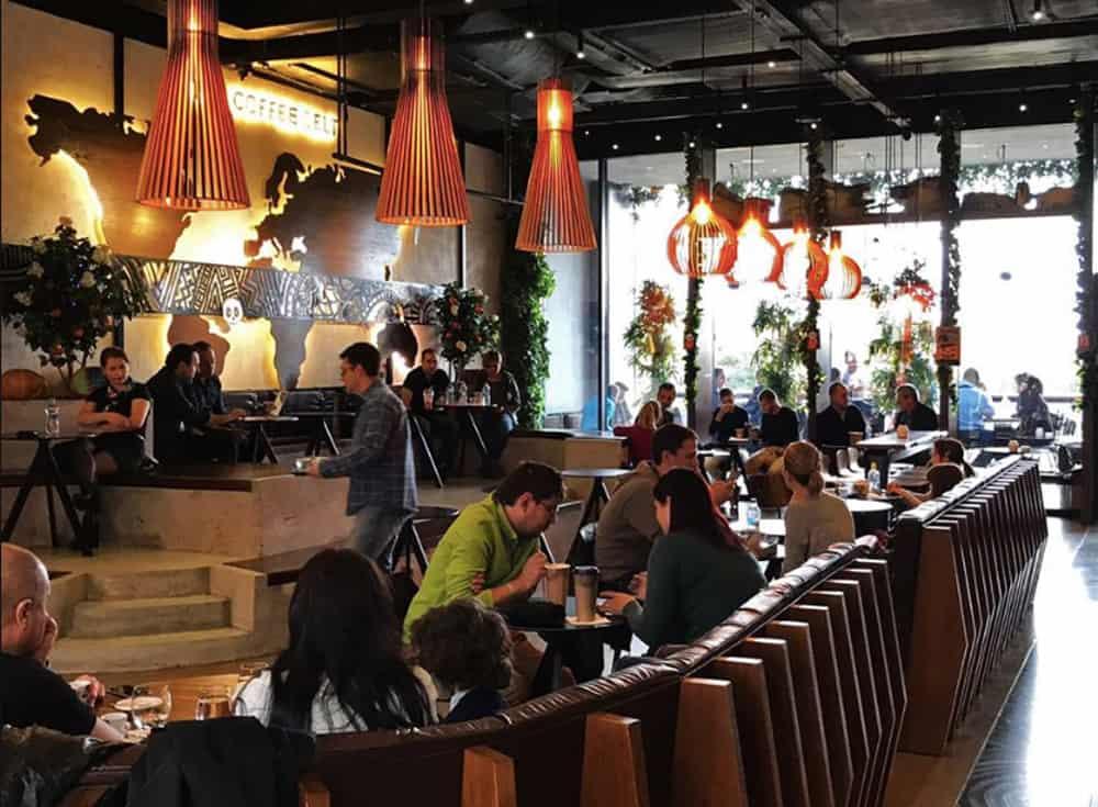 Busy coffee shop with dim lighting
