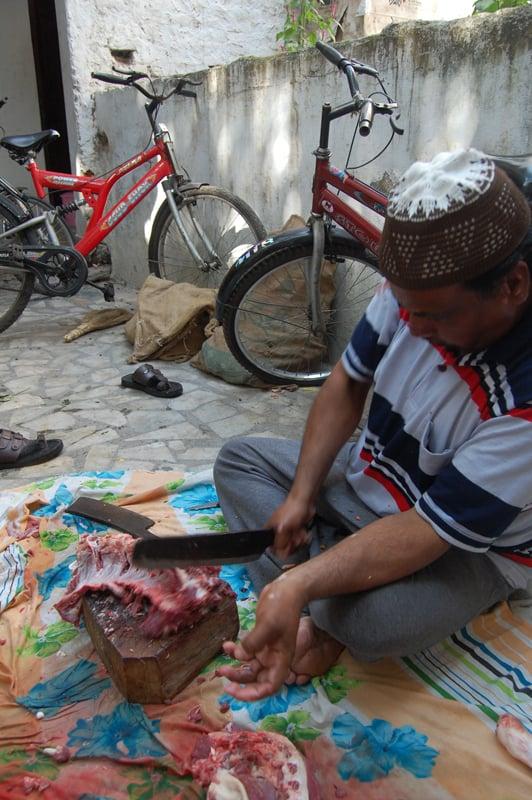 Man cuts meat