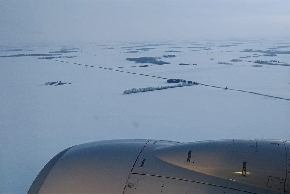 Snowy field viewed from an airplane