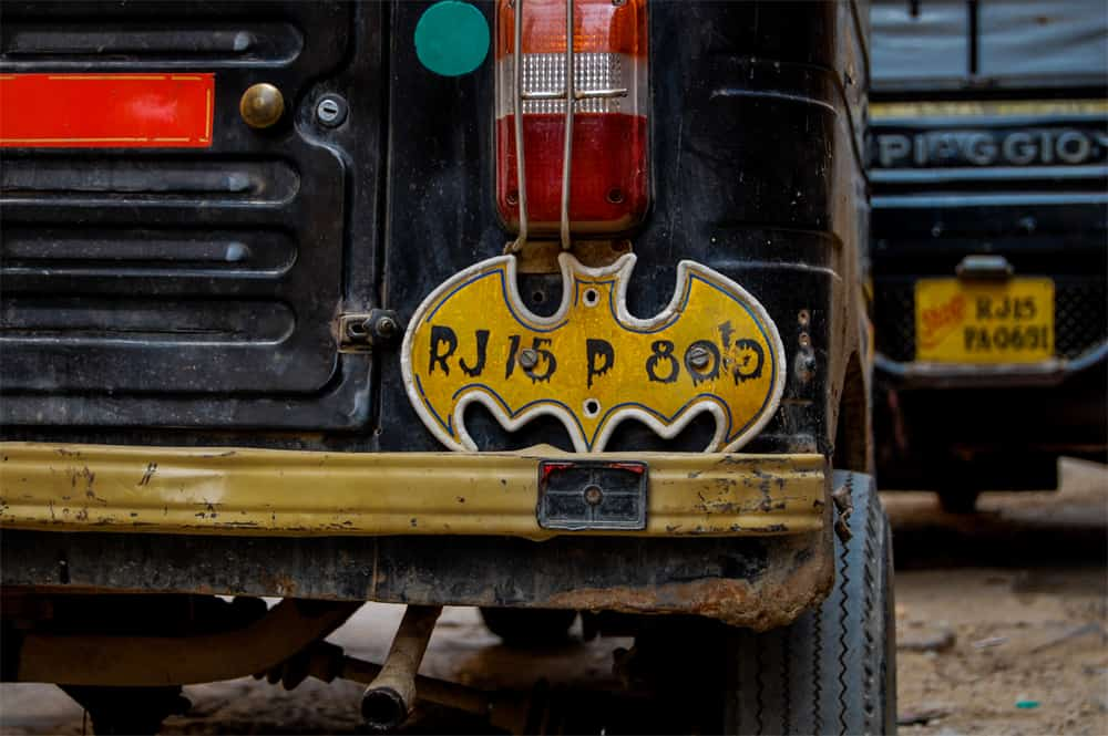 Black vehicle with a yellow batman logo licence plate