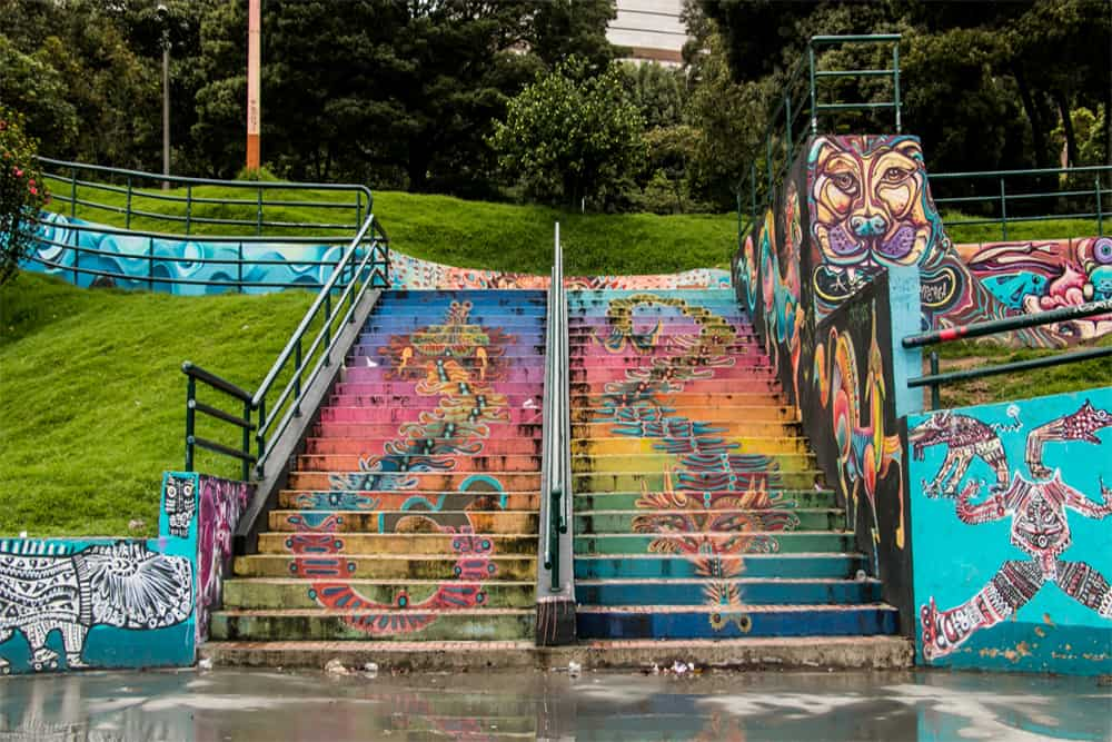 Bogota Graffiti Tour: A staircase in a park, brightly coloured in intricate graffiti