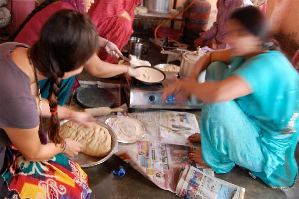 Women talking and making flatbread