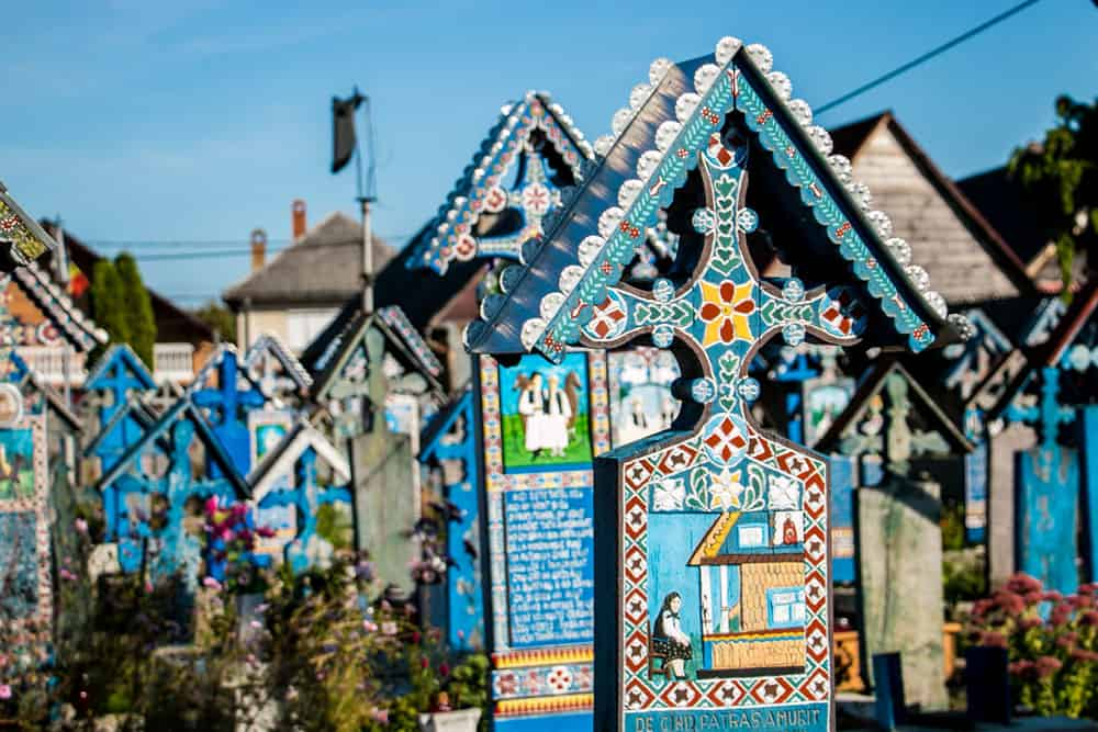 Blue crosses and gravestones with colourful art on them