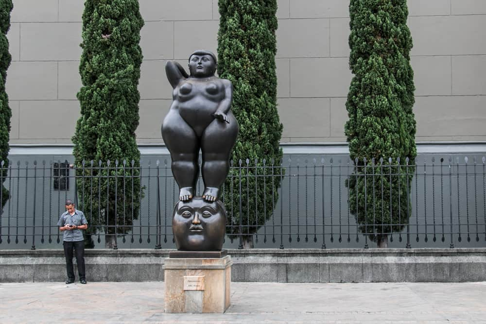 Statue of a large woman standing on a head