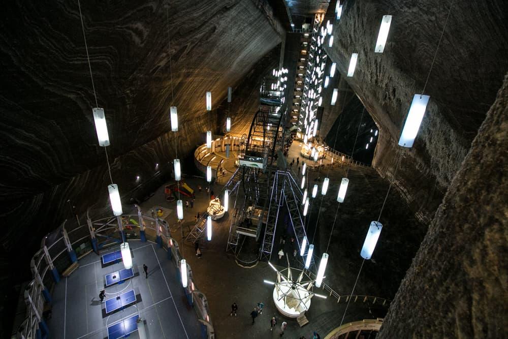 Underground, in a dark mine, several games and a Ferris wheel are seen.
