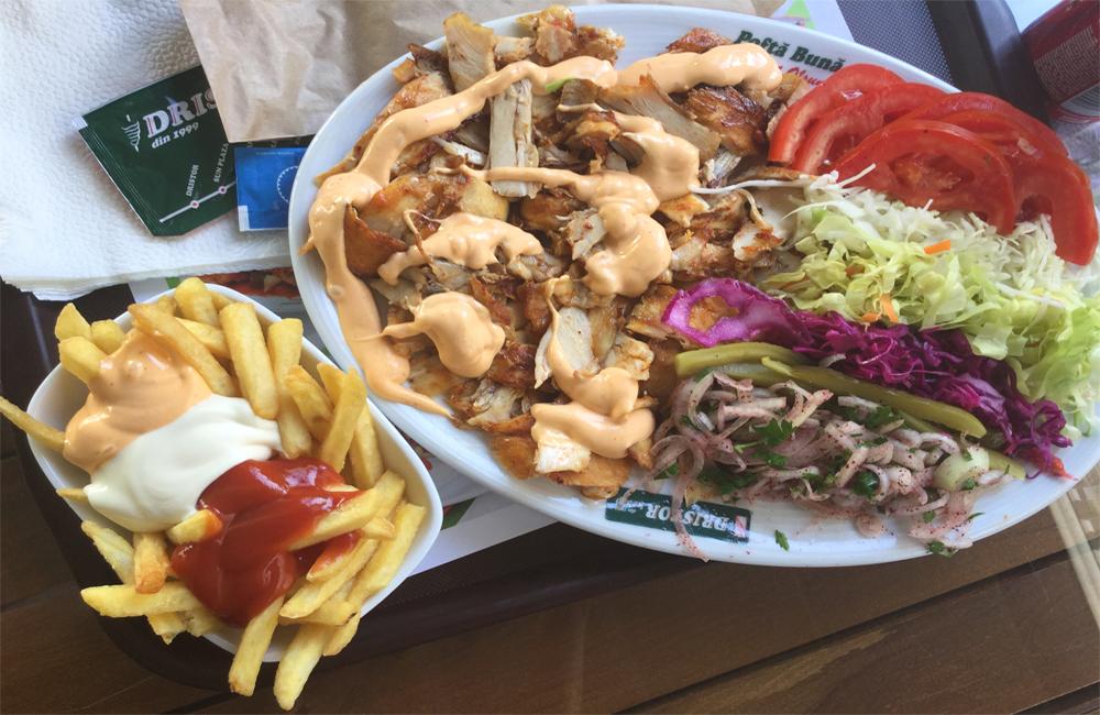 A massive chicken shawarma platter from Dristor Kebap in Bucharest
