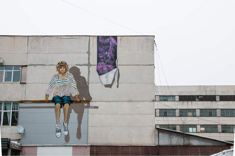 Graffiti of a girl on the wall of a building