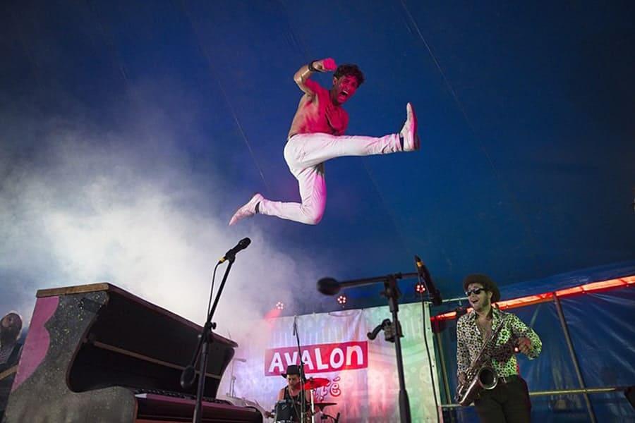 Man in white pants jumping