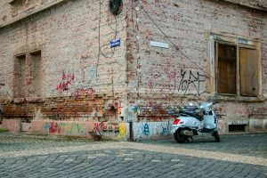 Brick wall with a white scooter