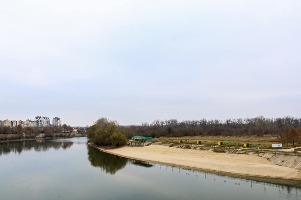 Sandy beach along a calm river