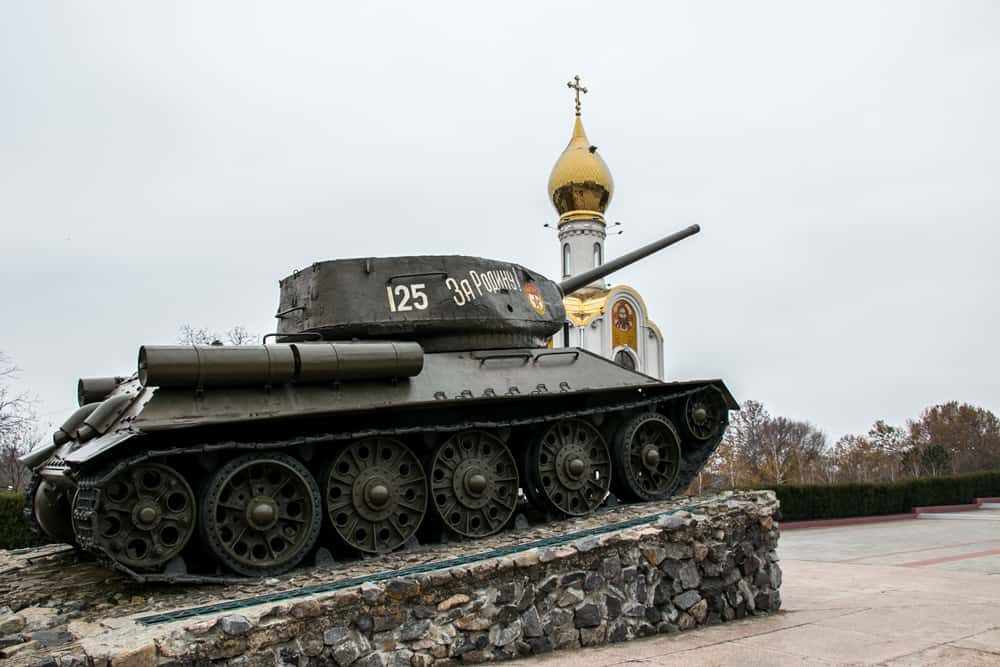 Soviet tank and a gold-topped church on a street