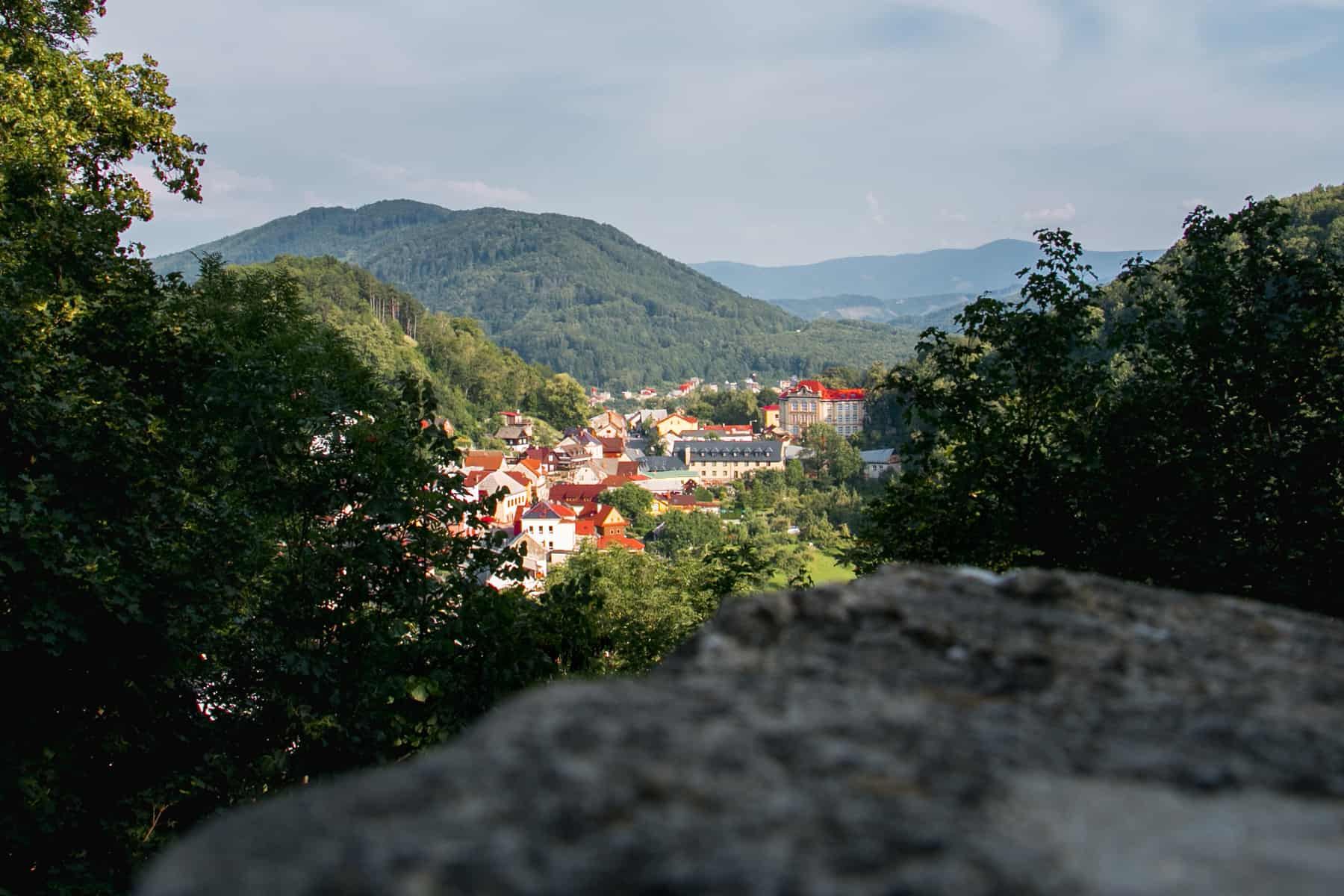 Looking over a rock at a village with red rooftops