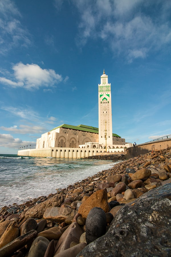Tall white mosque on the edge of the sea