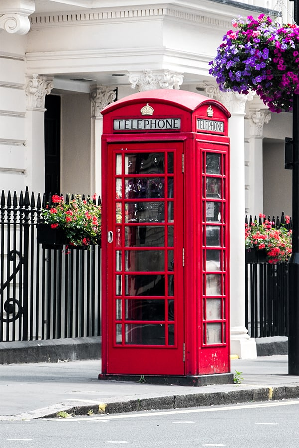 Red phone box on a street in London