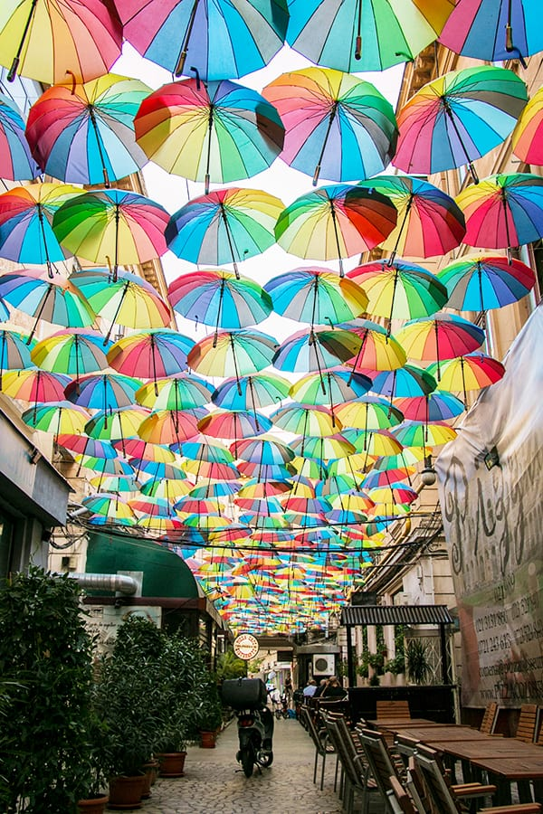 Colourful umbrellas in an alley